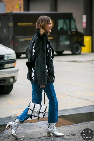 coat tumblr fur coat alexa chung black coat streetstyle denim jeans blue jeans bag white bag boots silver boots