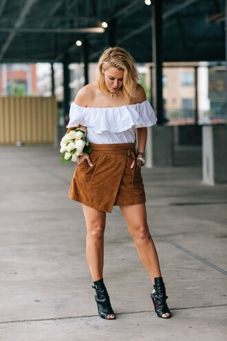 the courtney kerr blogger jewels mini skirt suede skirt off the shoulder white top wrap skirt black boots jewelry peep toe heels white off shoulder top ruffle top ruffled top off the shoulder top asymmetrical asymmetrical skirt flowers necklace high heels peep toe boots