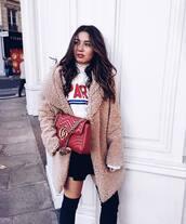 coat,tumblr,teddy bear coat,camel fluffy coat,camel coat,fluffy,fuzzy coat,top,white top,quote on it,skirt,mini skirt,black skirt,over the knee boots,bag,red bag,gucci,gucci bag,designer bag,chain bag