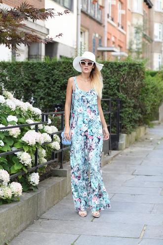 from brussels with love blogger jewels jumpsuit shoes bag floral jumpsuit summer outfits sun hat sandals shoulder bag blue bag