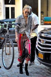 pants,ankle boots,gigi hadid,streetstyle,model off-duty,shirt,blouse,top