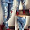 Women's distressed bleach ripped knee skinny jeans