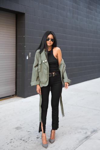 walk in wonderland blogger belt black pants army green jacket black top grey heels