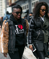 top,nyfw 2017,fashion week 2017,fashion week,streetstyle,black hoodie,quote on it,jacket,black jacket,black leather jacket,leather jacket,pants,black pants,black leather pants,leather pants,sunglasses