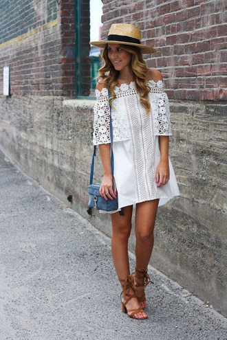 twenties girl style blogger dress hat shoes lace dress eyelet detail eyelet dress mini dress off the shoulder off the shoulder dress summer dress summer outfits blue bag bag mid heel sandals sandals brown sandals straw hat block heels