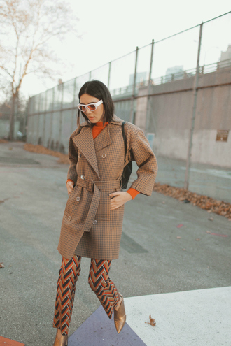 dylana suarez blogger coat sweater pants shoes sunglasses winter outfits boots trench coat orange sweater