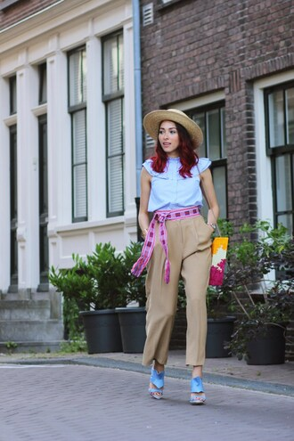 preppy fashionist blogger hat top belt pants shoes bag jewels work outfits blue shirt camel pants cropped pants high waisted pants straw hat sandals sandal heels high heel sandals blue sandals printed sandals