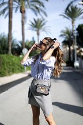 b a r t a b a c,blogger,crossbody bag,grey skirt,asymmetrical skirt,hun,wavy hair,blue shirt,mini bag,louis vuitton bag,boxed bag