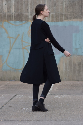 shot from the street blogger all black everything black coat minimalist