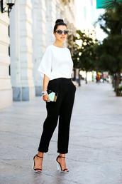 pants,white blouse,black trousers,strappy black heels,blue handbag,sunglasses,blogger