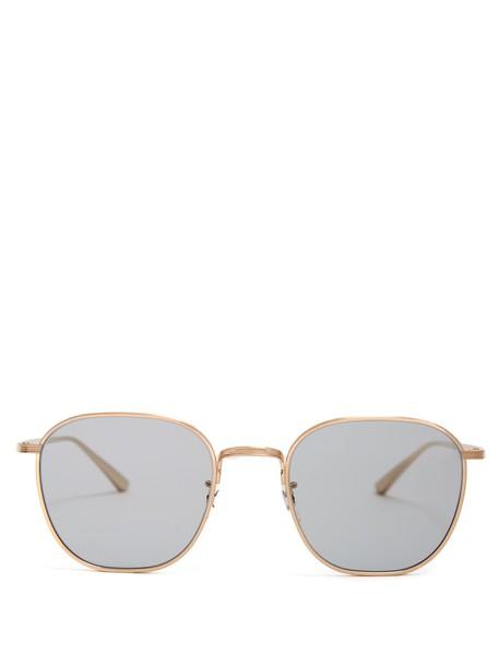 The Row sunglasses gold