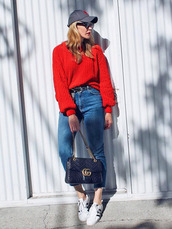 shoes,casual,sneakers,white sneakers,low top sneakers,denim,jeans,blue jeans,cropped jeans,sweater,red sweater,knit,knitwear,knitted sweater,cap