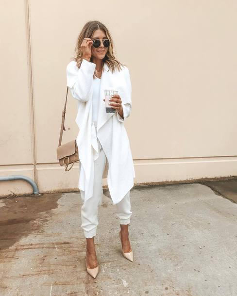 coat draped white pants wool white top pumps shoulder bag aviator sunglasses