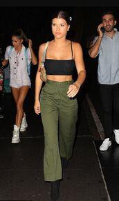 top,model off-duty,streetstyle,fashion week,sofia richie,crop tops,black top,pants