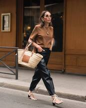 bag,basket bag,straw bag,mid heel sandals,black pants,blouse,round sunglasses,earrings