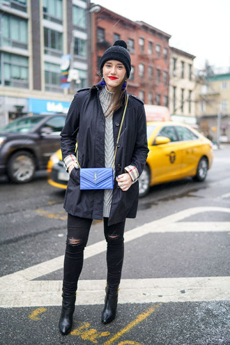 covering bases blogger yves saint laurent saint laurent bag blue bag mini shoulder bag grey sweater ripped jeans black jeans black boots grey cable knit sweater cable knit beanie pom pom beanie black beanie black ripped jeans