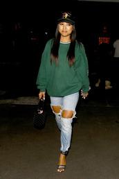 sweater,karrueche,streetstyle,ripped jeans,jeans,sandals,sweatshirt,cap,hat