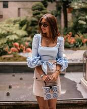 top,mini skirt,handbag,bracelets,ring,sunglasses