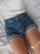 shorts,jeans,demim,denim,High waisted shorts,cuffed shorts,white tank top,cotton,sexy,tanned girl,nycfashion,front pockets,high waisted,white,top,blue,pockets,frayed,cute,summer,denim shorts,90s style,blue shorts,mini,buttons,legs