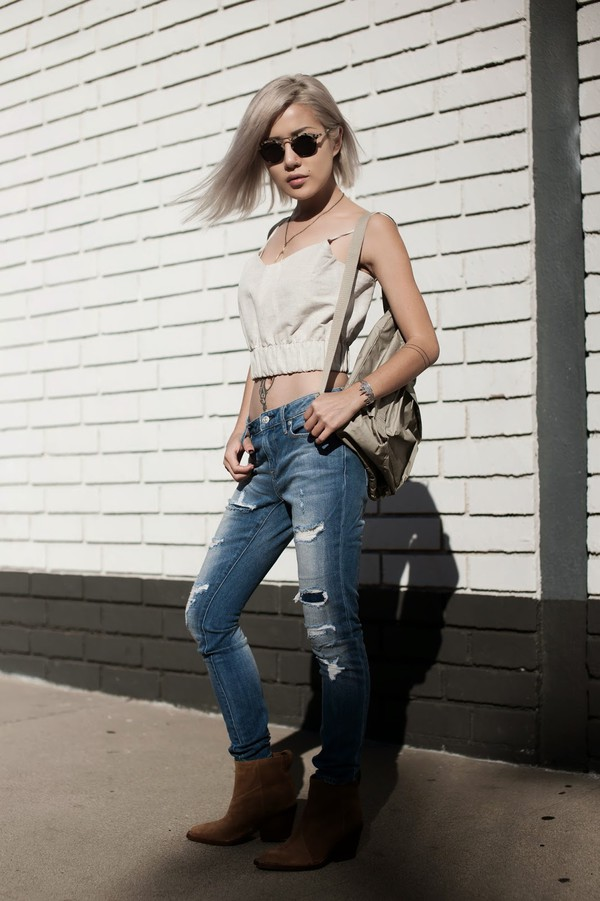 feral creature blogger top jeans jewels ripped jeans sunglasses