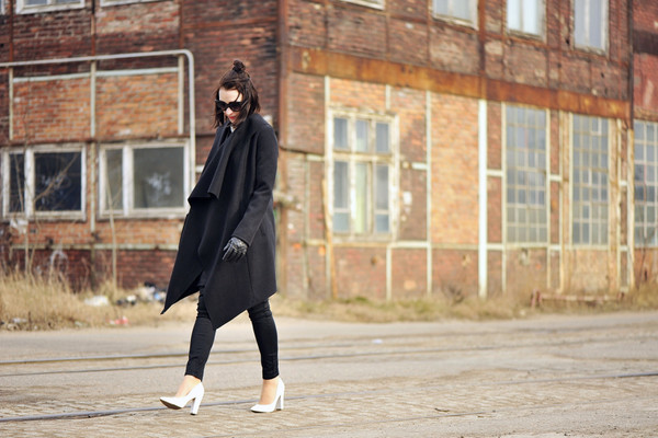 shiny sil blogger gloves white shoes black coat black jeans blouse top bag jeans sunglasses socks