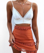 t-shirt,skirt,holidays,orange,tassel,cute,summer,fringes,layered,pom poms,shirt,white crochet lace cropped,orange tassel skirt,white,lace,spaghetti strap,bralette