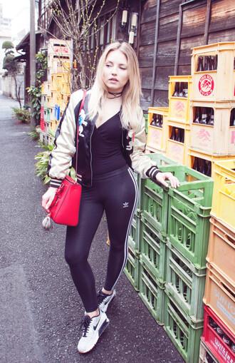 cherryblossomstreet blogger jacket black top tank top black pants adidas red bag shoulder bag bomber jacket floral jacket white sneakers nike
