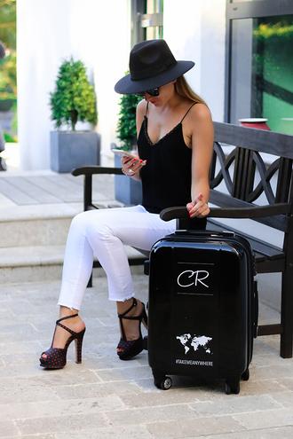 heels on gasoline blogger suitcase cropped jeans sandal heels white jeans black tank top
