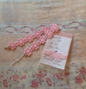 jewels,choker necklace in pink flower lace,earphones,gloves,belt