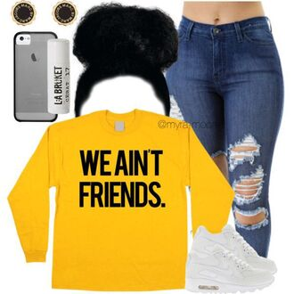 sweater sweater weather yellow black graphic tee bold black letters oversized sweater jeans ripped jeans denim high waisted jeans nike running shoes nike nike shoes white make-up lipstick lip balm dope urban school outfit