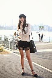 natalie off duty,blouse,shoes,bag,fringes,fringed shorts,black shorts,suede shorts,white blouse,lace top,bucket bag,black bag,flats,black flats