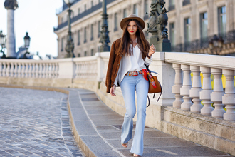 the mysterious girl blogger jeans shirt jacket scarf top hat bag shoes jewels