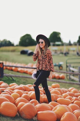 stephanie sterjovski - life + style blogger hat shoes bag long sleeves orange skinny jeans ripped jeans round sunglasses aviator sunglasses black hat