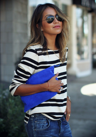 blouse blue bag blue bags swede rayban ray bans ray bans sunglasses stripes striped shirt black black and white white white and black blouse black and white blouse black and white striped shirt jeans denim blue jeans jewels earrings ring bracelets bracelet chains medallion classy streetwear streetstyle bag suede suede bag suede clutch blue clutch blue overalls grundge cool smart