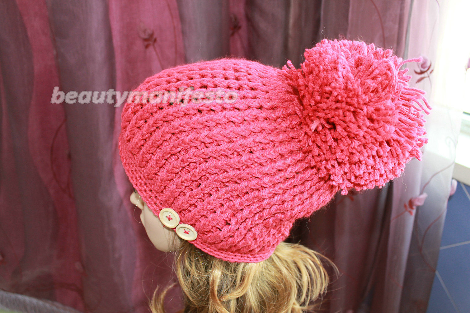 Pom pom hat in red hand crocheted