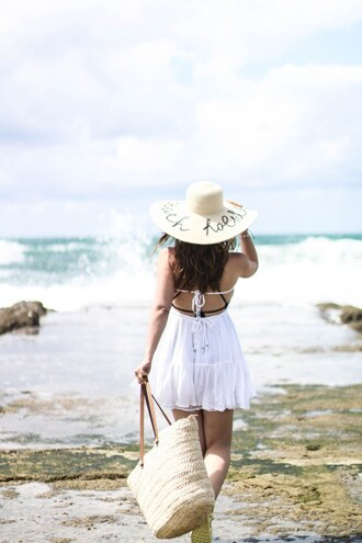 elodie in paris blogger swimwear romper white dress beach summer dress sun hat beach bag raffia bag customized beach hat straw hat customized summer outfits basket bag straw bag beach dress big hat woven bag