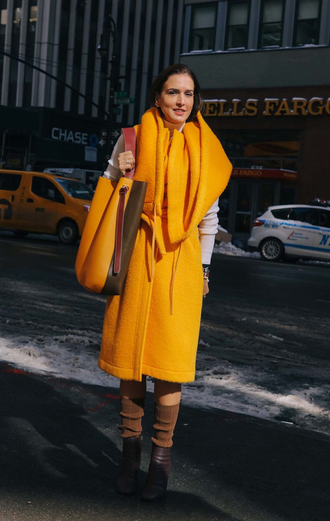 coat nyfw 2017 fashion week 2017 fashion week streetstyle yellow yellow coat sweater white sweater socks boots brown boots ankle boots bag yellow bag