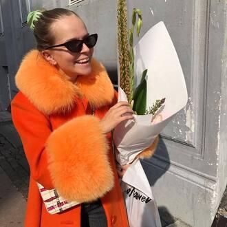 coat orange coat sunglasses black sunglasses
