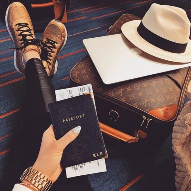 hat passport cover black pants black pants sneakers gold sneakers louis vuitton travel bag felt hat white hat