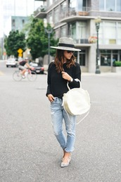 crystalin marie,blogger,sweater,jeans,hat,bag,jewels,ripped jeans,black sweater,white bag,heels,bell sleeves,black top,bell sleeve top,round bag,blue jeans,cropped jeans,pointed flats,flats,spring outfits,round tote