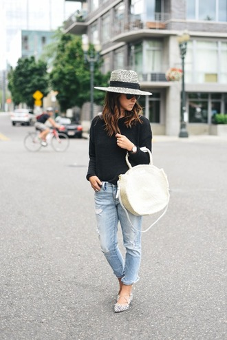 crystalin marie blogger sweater jeans hat bag jewels ripped jeans black sweater white bag heels bell sleeves black top bell sleeve top round bag blue jeans cropped jeans pointed flats flats spring outfits round tote