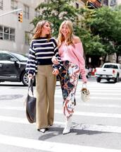sweater,oversized sweater,v neck,pink sweater,asymmetrical skirt,printed skirt,white boots,wide-leg pants,checkered pants,handbag,jumper