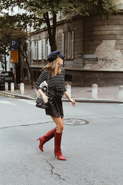fashion and style blogger hat bag sunglasses shoes tumblr boots red boots knee high boots skirt mini skirt black leather skirt leather skirt top stripes striped top fisherman cap