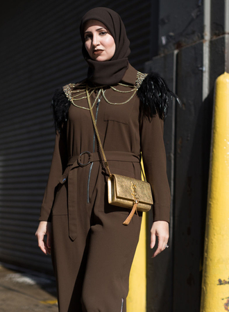 jumpsuit gold bag nyfw 2017 fashion week 2017 fashion week brown bag crossbody bag tassel ysl ysl bag metallic long sleeves