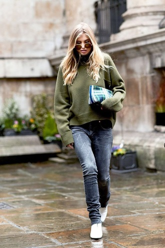 jeans black jeans denim sweater green sweater bag sunglasses boots pouch