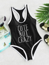 swimwear,cute but crazy,girly,black,black and white,white,one piece swimsuit,one piece,quote on it,bodysuit