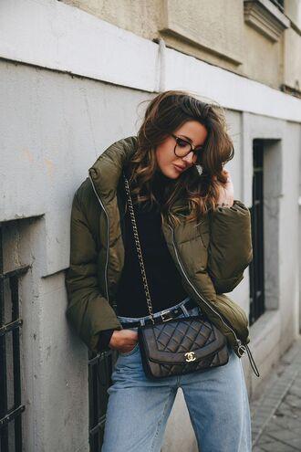 jacket jeans black belt black purse blogger glasses black turtleneck top green puffer jacket