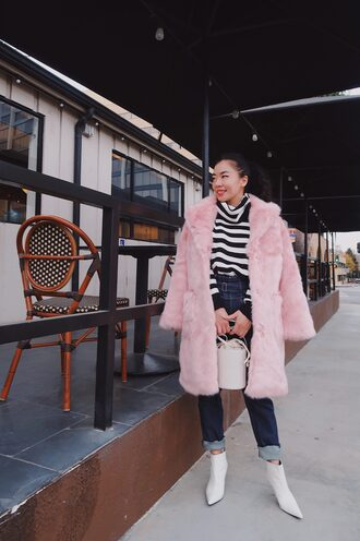 hallie daily blogger sweater bag winter outfits pink fur coat faux fur coat ankle boots white boots striped sweater