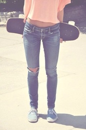 jeans,ripped jeans,skateboard,skater,crop tops,vans,orange,peach,skate board,blue shoes,sweater