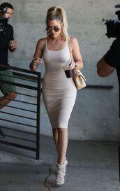 dress,khloe kardashian,sunglasses,bag,high heels,hair accessory,bracelets,necklace,shoes,bodycon dress,nude dress,nude bag